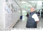 Shri K. M. Hanumantharayappa, Chairman, CSB looking at the Sericulture info-flex on display during the meet